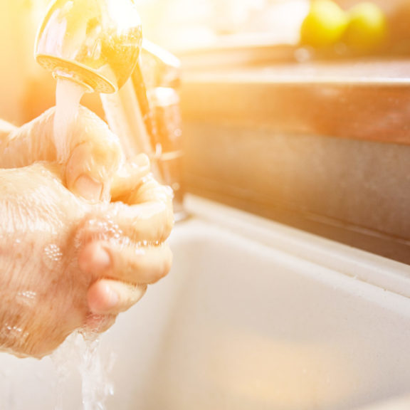 Elderly woman washing hands with soap in coronavirus epidemic